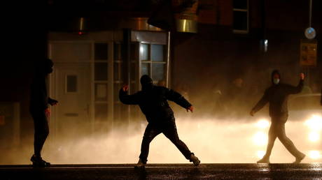 Rioters react as the police uses a water cannon on the Springfield Road as protests continue in Belfast, Northern Ireland April 8, 2021
