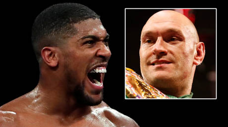 Boxing champions Anthony Joshua (left) and Tyson Fury could fight in Russia © Andrew Couldridge / Reuters   © Steve Marcus / Reuters