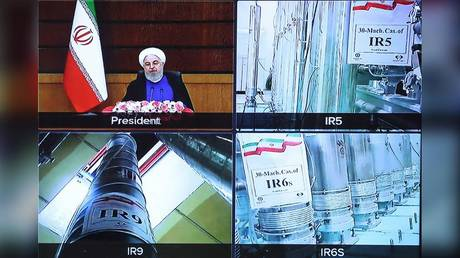A screen grab from a videoconference showing views of centrifuges at Iran's Natanz uranium enrichment plant, as well as President Hassan Rouhani.