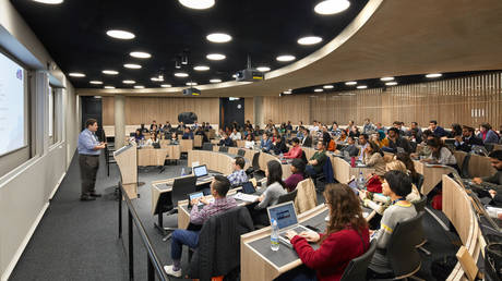 Curved lecture hall with students. The Blavatnik School of Government at the University of Oxford, Oxford, United Kingdom.