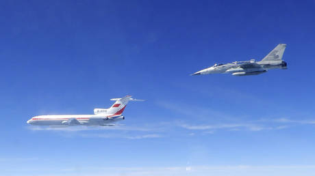 Taiwan's Ministry of National Defense, a Taiwanese Air Force Indigenous Defense Force (IDF) fighter aircraft, right, flies near a Chinese People's Liberation Army Air Force (PLAAF) TU-154 aircraft.