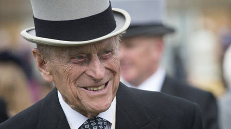 Britain's Prince Philip, Duke of Edinburgh greets guests at a garden party at Buckingham Palace in London on May 16, 2017.