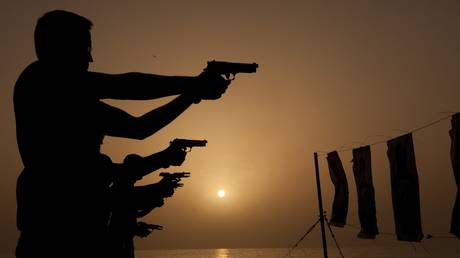 Sailors fire M9 service pistols during small weapons training aboard the guided-missile destroyer USS Nitze DDG 94, Gulf Of Aden, 2012.