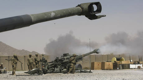 U.S. Army soldiers from 2nd Platoon, B battery 2-8 field artillery, fire a howitzer