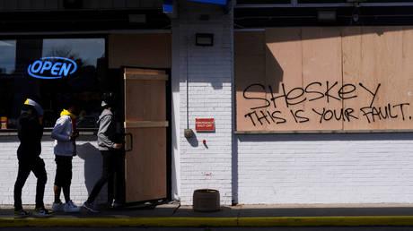 FILE PHOTO. Graffiti making a reference to Rusten Sheskey, in Kenosha, Wisconsin. ©REUTERS / Stephen Maturen