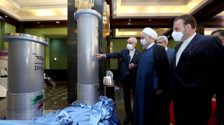 President Hassan Rouhani inspects uranium enrichment centrifuges on display during Iran's National Nuclear Energy Day in Tehran, Iran April 10, 2021.