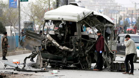 FILE PHOTO: FILE PHOTO: Afghan officials inspect a damaged minibus after a blast in Kabul. © Reuters / Mohammad Ismail