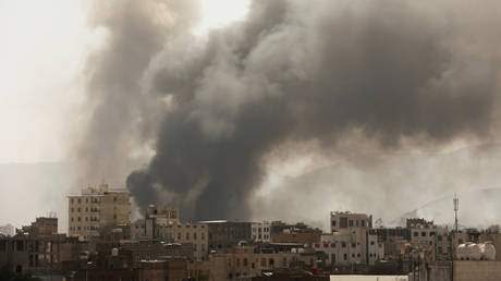 Smoke billows from the site of Saudi-led air strikes in Sanaa, Yemen March 7, 2021