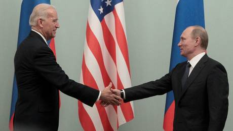 FILE PHOTO: Russian Prime Minister Vladimir Putin (R) shakes hands with U.S. Vice President Joe Biden during their meeting in Moscow March 10, 2011.