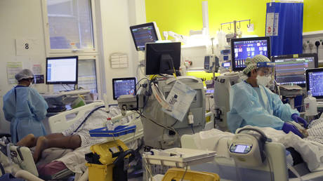 Critical Care staff take care of COVID-19 patients on the Christine Brown ward at King's College Hospital in London, Wednesday, Jan. 27, 2021.