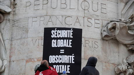 """Activists from the anti-globalisation organisation Attac protest against a """"global security bill"""" at the Place de la Republique in Paris, France, (FILE PHOTO) © REUTERS/Benoit Tessier"""