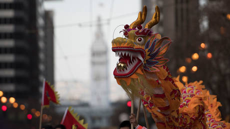 FILE PHOTO. People perform dragon dance during San Francisco Chinese New Year Parade © Getty Images / Yichuan Cao