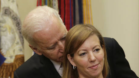 FILE PHOTO: US Vice President Joe Biden talks to Stephanie Carter as her husband Ash Carter (not pictured) delivers his acceptance speech as the new Secretary of Defense, February 17, 2015