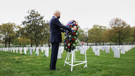 The 'bounties' story was cited by now-President Joe Biden (pictured at Arlington National Cemetery, April 14, 2021) during the 2020 campaign. © Reuters / Tom Brenner