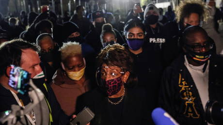 US Representative Maxine Waters (D-CA) is surrounded by members of the media as she makes an appearance outside the Brooklyn Center Police Department, April 17, 2021