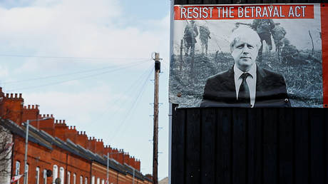 FILE PHOTO. A poster depicting Britain's Prime Minister Boris Johnson is seen in Belfast, Northern Ireland. © REUTERS/Jason Cairnduff
