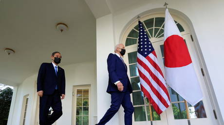 US President Joe Biden walks out of the Oval Office with Japan's Prime Minister Yoshihide Suga ahead of a news conference at the White House in Washington, US (FILE PHOTO) © REUTERS/Tom Brenner