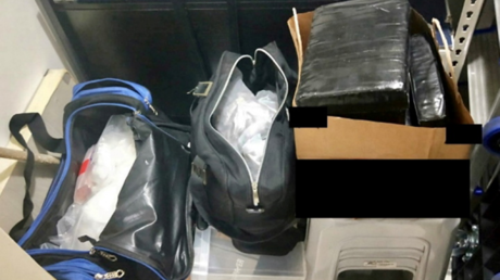 Bundles containing illicit drugs seized by local police from a storeroom in a residential unit in Singapore are pictured in this handout image taken April 19, 2021. © Reuters / Central Narcotics Bureau Singapore