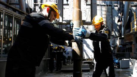 Employees work on drilling rig at Rosneft-owned Prirazlomnoye oil field outside Nefteyugansk, Russia
