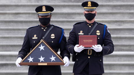 Cremated remains of Capitol Police officer Brian Sicknick lay in honor at the Capitol Rotunda prior to his funeral, February 3, 2021.