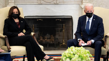 US Vice President Kamala Harris and US President Joe Biden wait for a meeting with the Congressional Hispanic Caucus in the Oval Office of the White House April 20, 2021, in Washington, DC.
