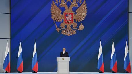 Russian President Vladimir Putin delivers his annual address to the Federal Assembly, including lawmakers of the State Duma, members of the Federation Council, regional governors and other officials, in Moscow, Russia.