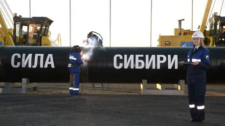 Welding the joint at the ceremony marking the joining of the first link in the Power of Siberia main gas pipeline attended by Russian President Vladimir Putin, held at Namsky Highway near Us Khatyn village.