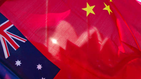 FILE PHOTO. Australian and Chinese flags