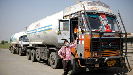 A driver stands next to an empty tanker as he waits to fill liquid oxygen in Ghaziabad, on the outskirts of New Delhi, India on April 22, 2021.