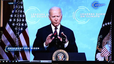 US President Joe Biden is seen on the screen as he attends the leaders summit on climate via video conference, in Brussels on April 22, 2021.