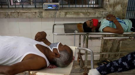 Patients wait to have their oxygen levels checked with a pulse oximeter after arriving at the emergency ward of Jawahar Lal Nehru Medical College and Hospital, during the coronavirus disease (COVID-19) outbreak, in Bhagalpur, Bihar, India, July 29, 2020.