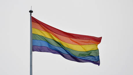 A pride flag waves in the wind in London