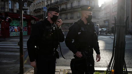 Police officers check people enjoying a sunny spring day along the banks of the canal Saint-Martin to enforce lockdown regulations, amid the coronavirus disease (COVID-19) outbreak, in Paris, France, April 4, 2021.