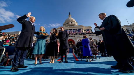 FILE PHOTO: Joe Biden is sworn in as the 46th president of the United States by Chief Justice John Roberts as Jill Biden holds the Bible during the 59th Presidential Inauguration at the US Capitol, in Washington, US, January 20, 2021