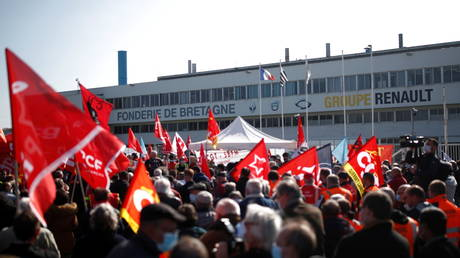 FILE PHOTO: Renault workers gather in front of the Fonderie de Bretagne, a subsidiary of Groupe Renault, in Caudan, France, March 23, 2021.
