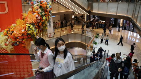 People visit a newly opened shopping mall in Beijing, China