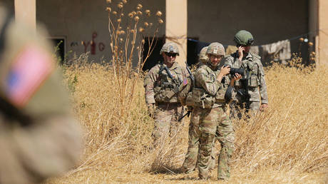 FILE PHOTO: Turkish and American soldiers stand near a former YPG military point during a joint U.S.-Turkey patrol, near Tel Abyad, Syria September 8, 2019.