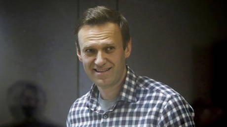 FILE PHOTO: Russian opposition politician Alexey Navalny attends a court hearing in Moscow, Russia February 20, 2021.