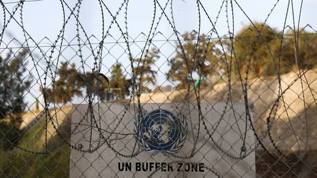 A United Nations sign is seen through barber wire at the UN-controlled buffer zone in Nicosia, Cyprus on April 29, 2021.