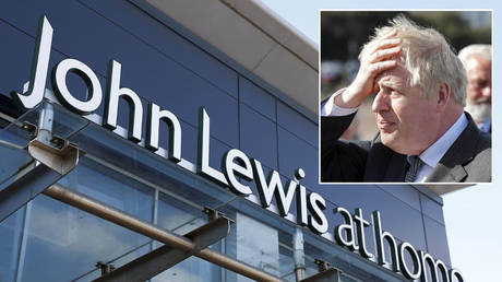 A view of a 'John Lewis at home' store that is closed due to the coronavirus disease (COVID-19) lockdown in Chester, Britain, March 24, 2021. © REUTERS / Jason Cairnduff; (inset) Boris Johnson © PHIL NOBLE / POOL / AFP