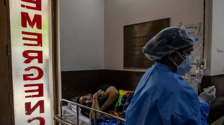 A patient suffering from the coronavirus disease (COVID-19) receives treatment inside the emergency ward at Holy Family hospital in New Delhi, India, April 29, 2021.