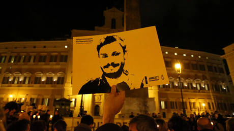 FILE PHOTO: A man holds a placard during a vigil to commemorate Giulio Regeni in downtown Rome, Italy, January 25, 2017