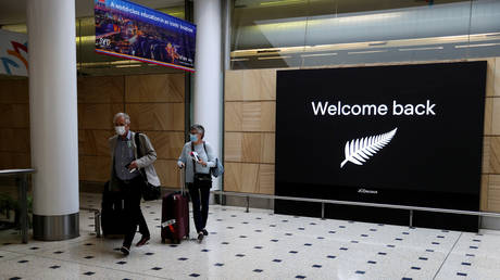 FILE PHOTO: Passengers arrive from New Zealand after the Trans-Tasman travel bubble opened overnight, following an extended border closure due to the coronavirus disease (COVID-19) outbreak, at Sydney Airport in Sydney, Australia, October 16, 2020.