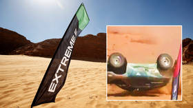 Massive crash: Female racer escapes after car flips in air and lands upside down at extreme rally in Saudi Arabian desert (VIDEO)