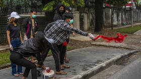 Myanmar streets painted red as activists protest military's violent coup amid rising death toll (PHOTOS)