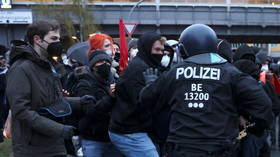 WATCH: Police and demonstrators scuffle in Berlin as thousands protest court ruling overturning city's rent cap