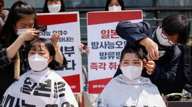 Seoul students shave heads in front of Japanese embassy to protest Tokyo's plan for dumping Fukushima nuclear wastewater