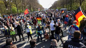 Thousands gather in Berlin to protest more Covid restrictions as parliament debates giving Merkel's govt power to impose lockdowns