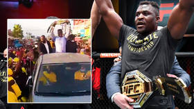 Francis Ngannou mobbed on return to Cameroon as UFC heavyweight king hands belt to his mom amid wild scenes on streets (VIDEO)