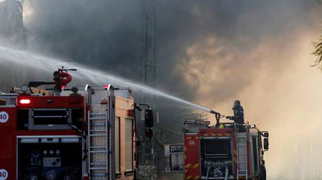 FILE PHOTO. Israeli firefighters.